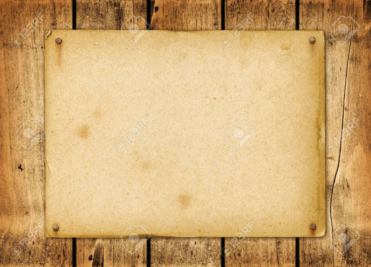 blank vintage poster nailed on a wood board panel stock photo