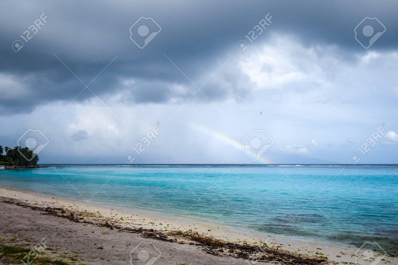 Rainbow On Temae Beach Lagoon In Moorea Island French Polynesia