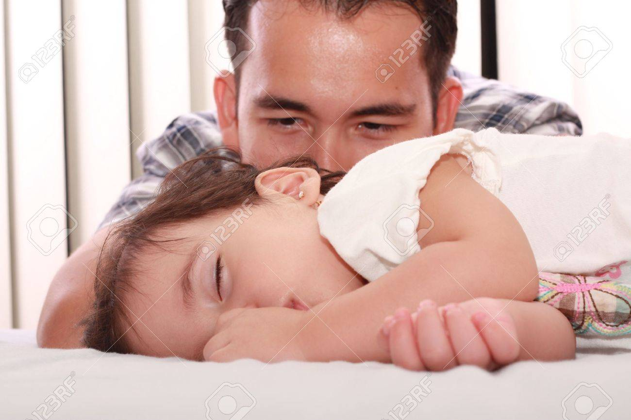 Father watch his beautiful baby while she sleeps Stock Photo - 9596143