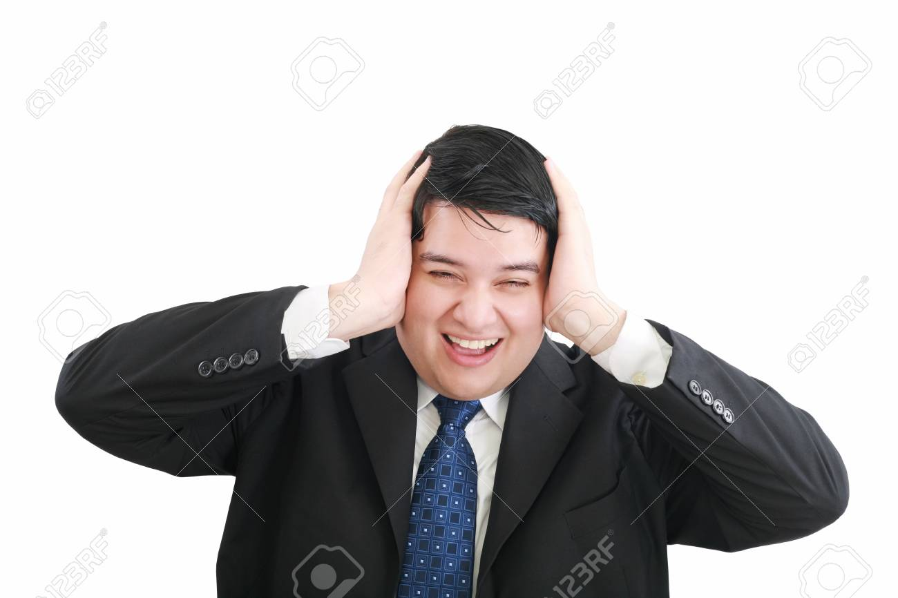 Frustrated young businessman pulling his hair, studio shot Stock Photo - 12534417