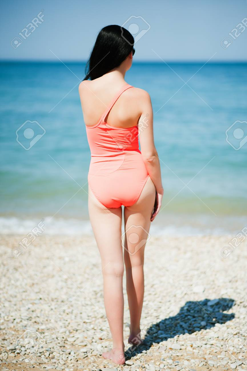 Woman rest on a beach. Portrait of the beautiful girl close-up, the wind fluttering hair. Stock Photo - 27263004