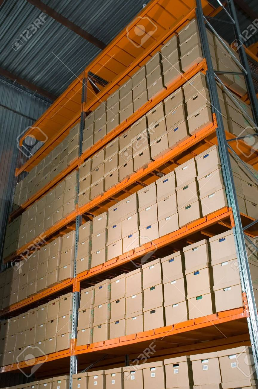 Cardboard boxes on the shelves in the warehouse Stock Photo - 619344