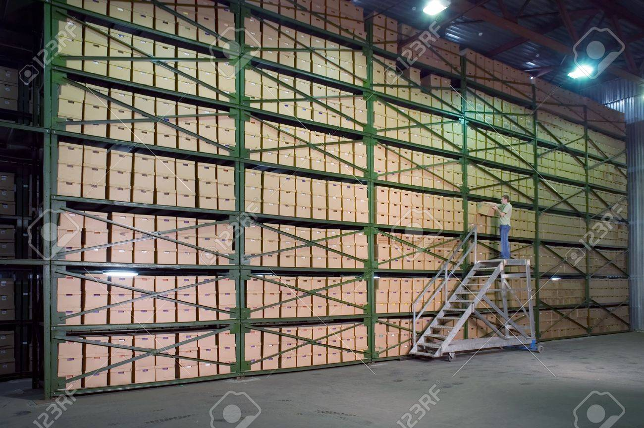 Man working on the stairs in the warehouse Stock Photo - 619339