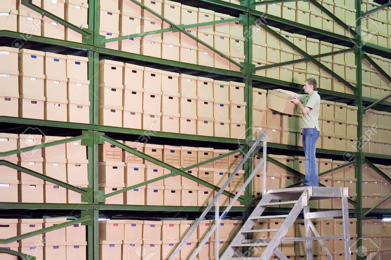 Man working on the stairs in the warehouse Stock Photo - 619356