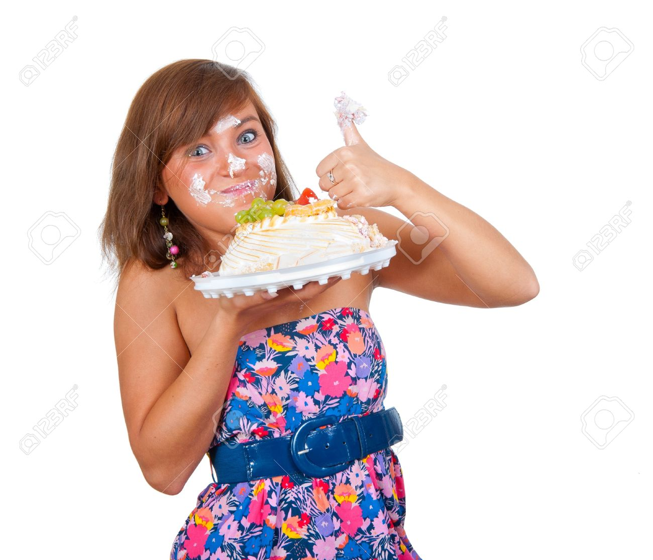 Girl eating cake with his hands, her face stained cream. Stock Photo - 7314731