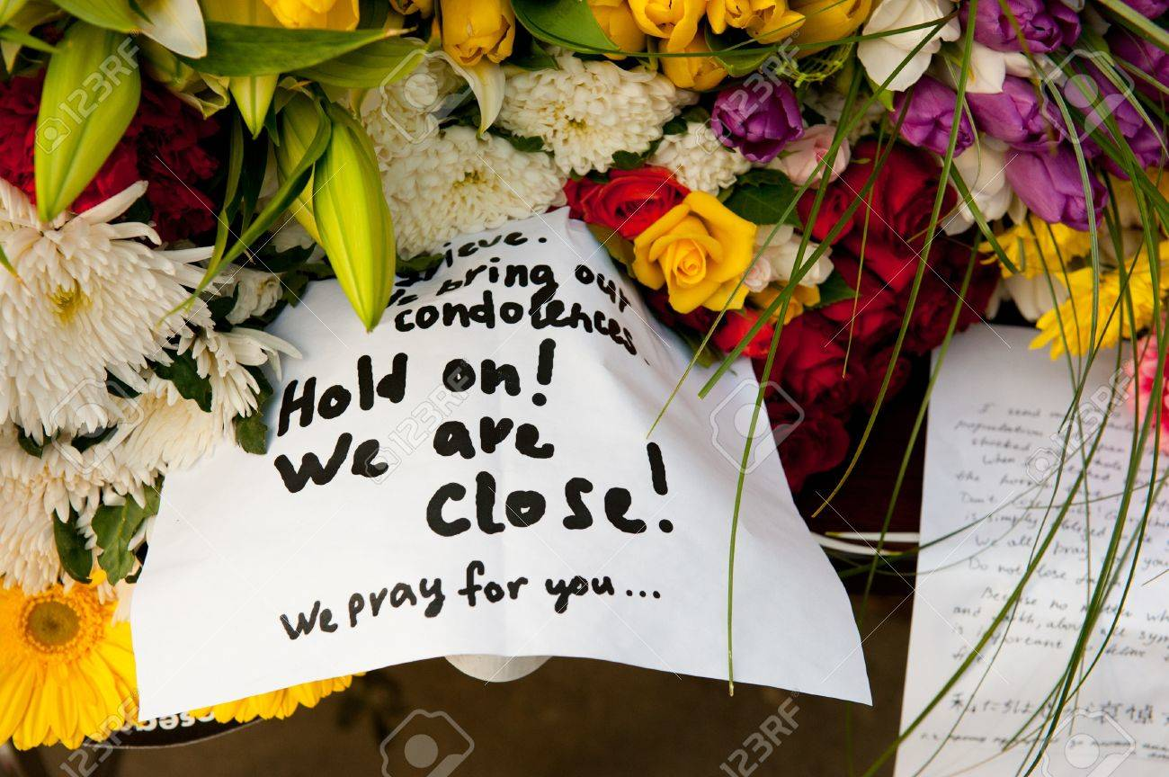 MOSCOW - MARCH 14: Flowers and a note of sorrow as a sign of sympathy to Japanese people affected by earthquake at the Japanese Embassy on March 14, 2011 in Moscow, Russia. Stock Photo - 9025233