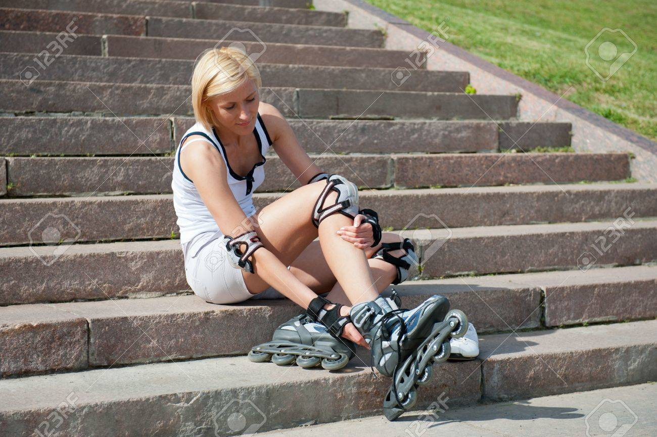 Young woman wears roller skates on the stairs Stock Photo - 9758131