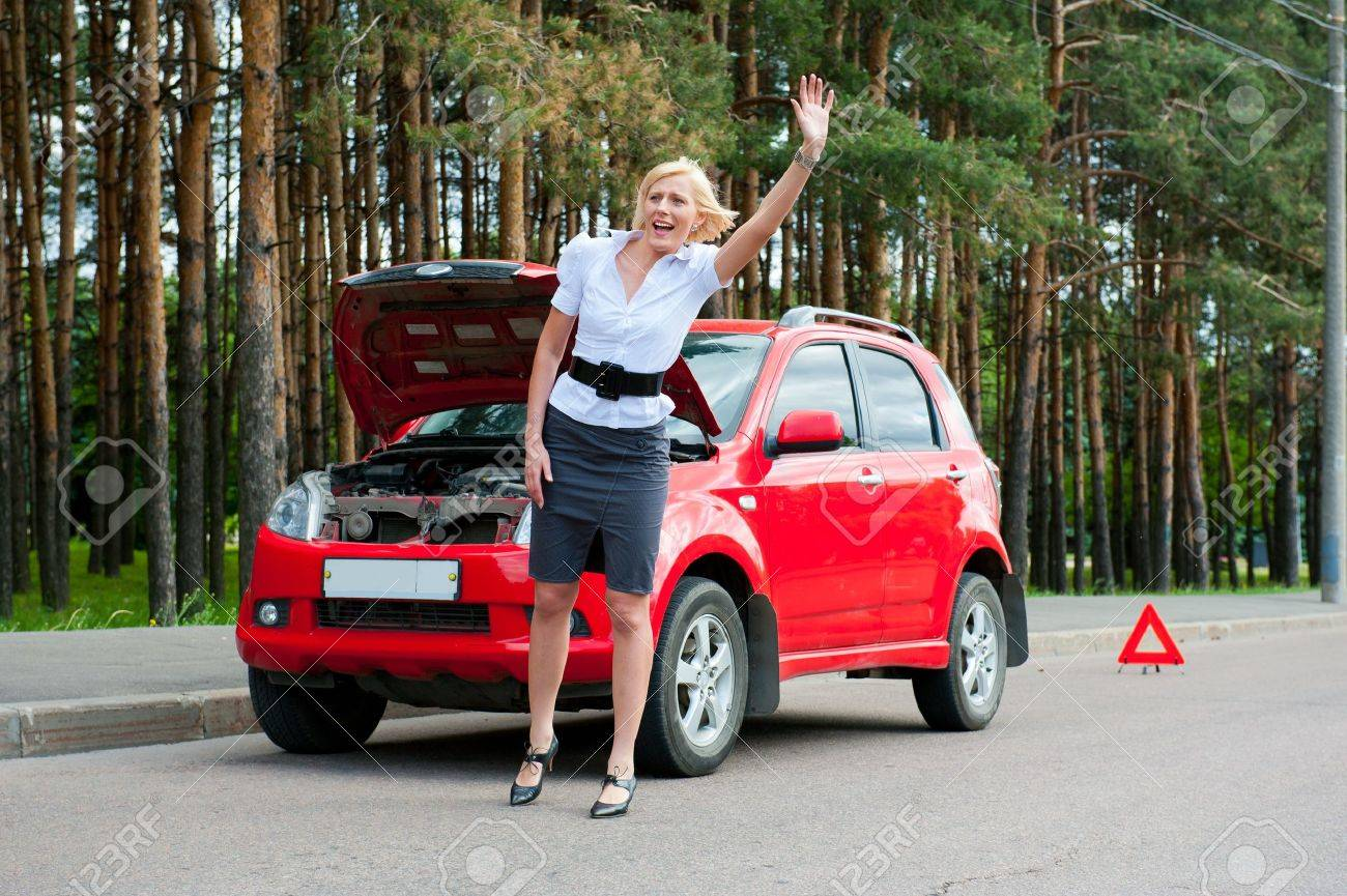 Blonde girl asks for help on the road near her broken car - 9954958