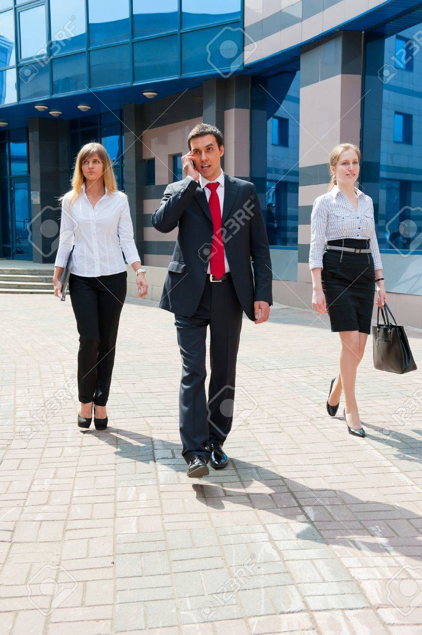 Business people walking in modern city downtown - 9956305