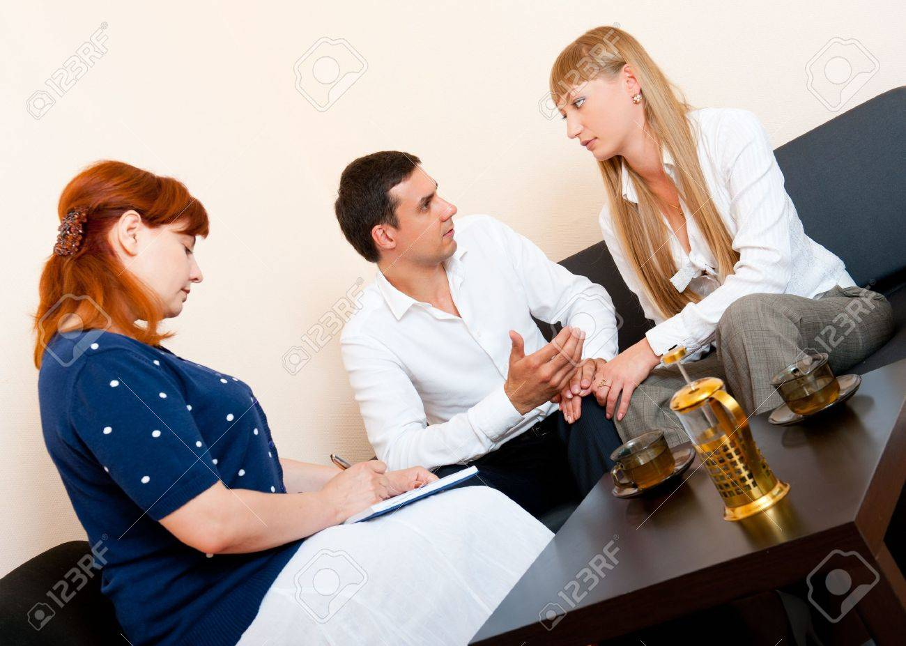 Young married couple consults at the psychologist - 10065453