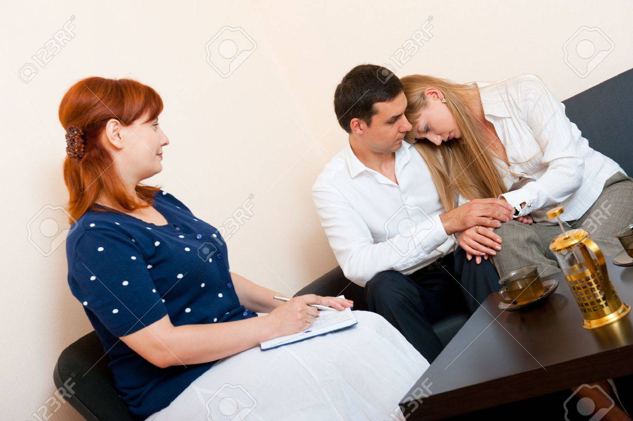 Young married couple consults at the psychologist - 10422821