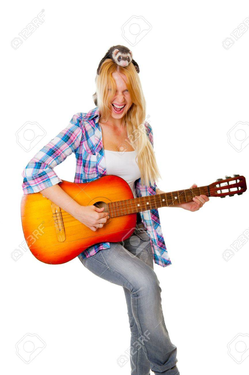 Girl playing the guitar, on her head sits a ferret Stock Photo - 10770489