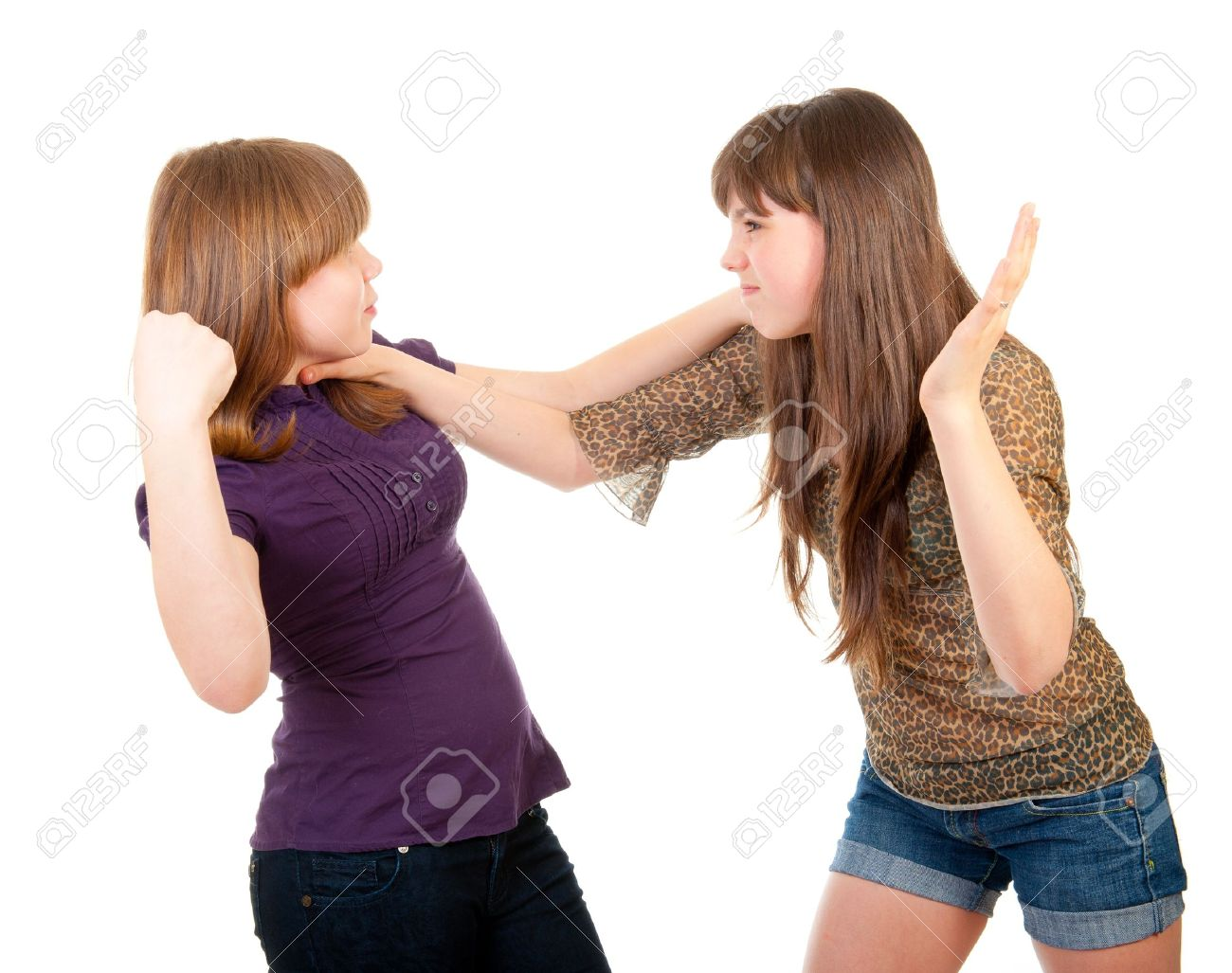 Fighting teen girls isolated over white background - 10802164