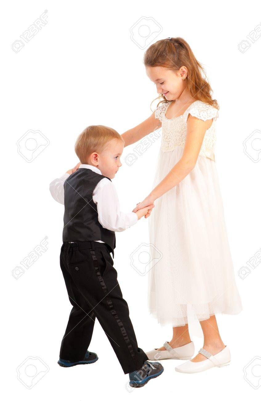 Boy and girl learning to dance isolated over white - 11295695