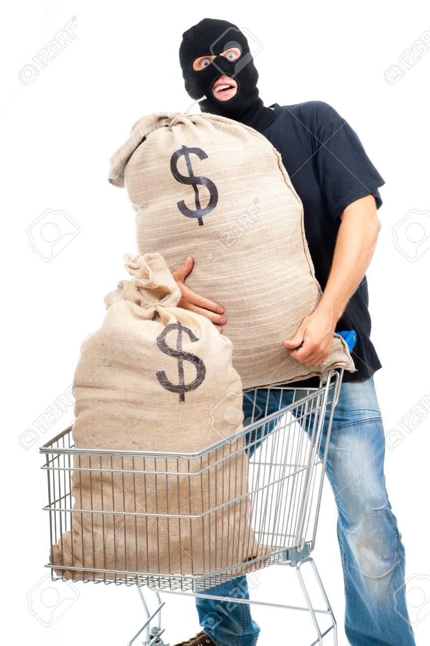 Happy robber with sacks full of dollars isolated on white Stock Photo - 11620906