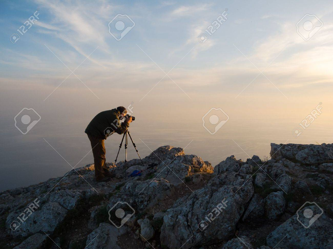 Photographer take a picture on a nature - 13656272