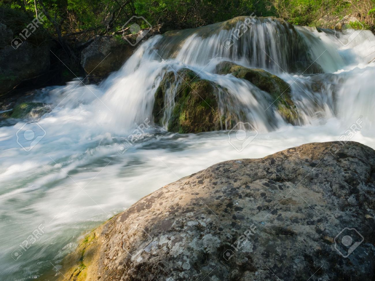 Flowing water in mountain river - 13710330