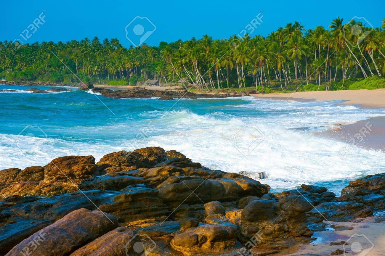 Tropical beach near Tangalle, Sri Lanka. Stones at foreground - 15053672