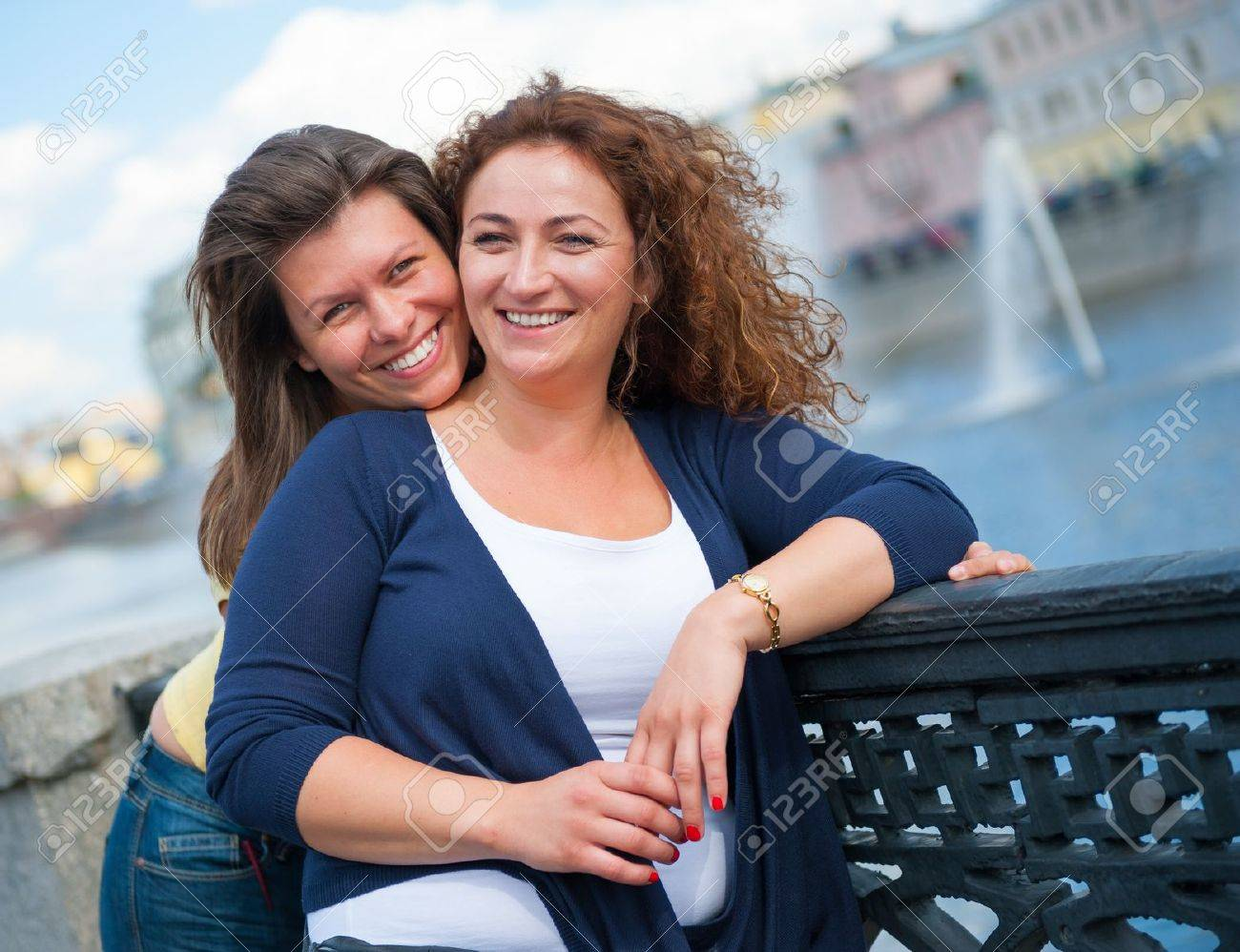 Portrait of two happy young beautiful women - 16523129