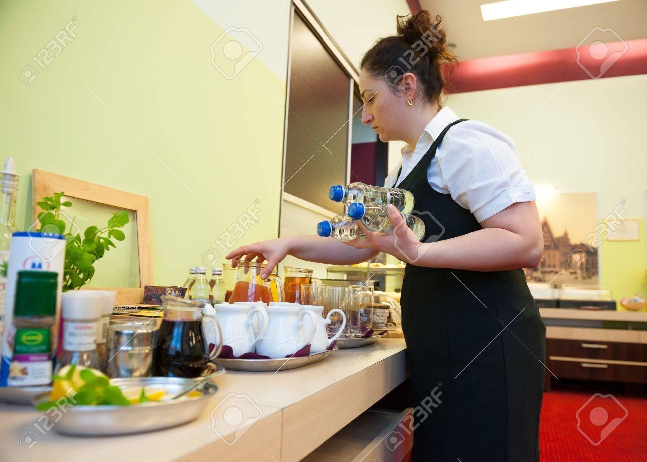 Waitress serving breakfast in the hotel - 17317455