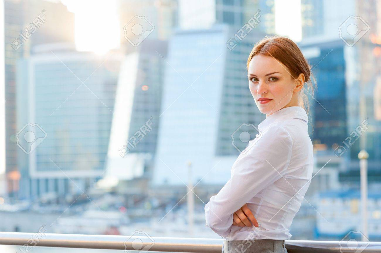 Young business woman on the modern city downtown background - 19339605