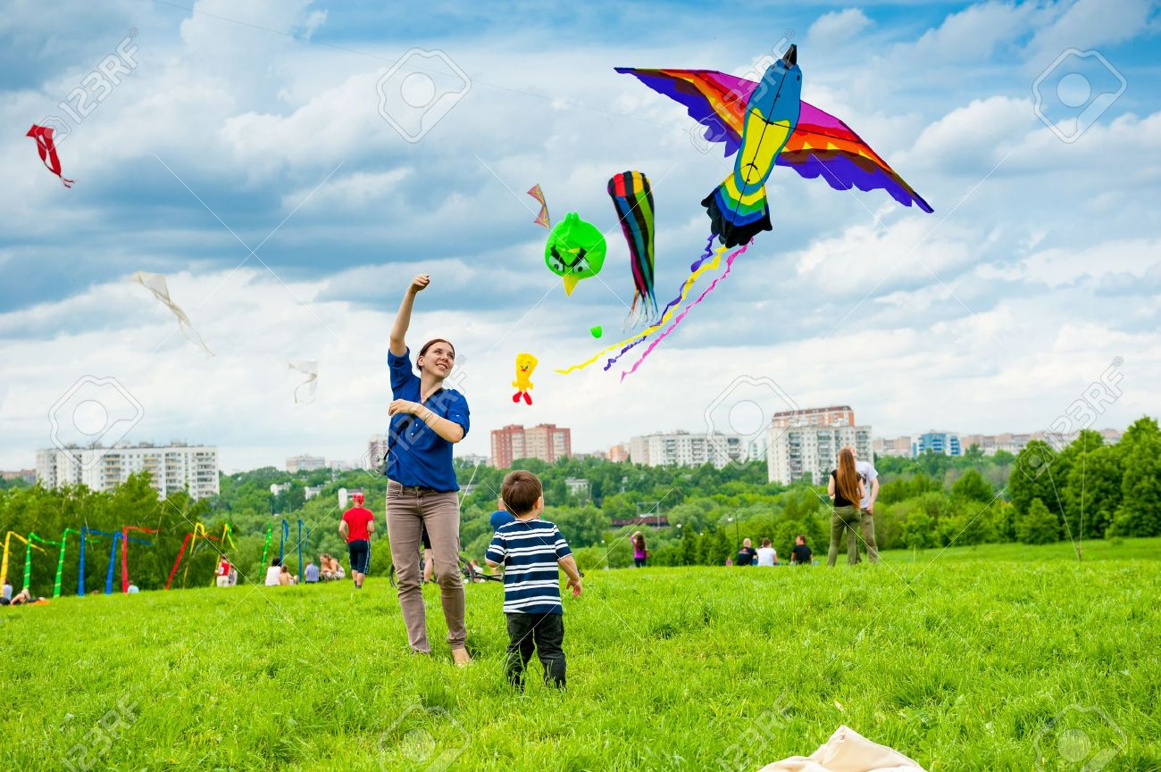 MOSCOW - MAY 25: Unidentified people fly kites at the kite festival in the park Tsaritsyno on May 25, 2013 in Moscow. - 20029627