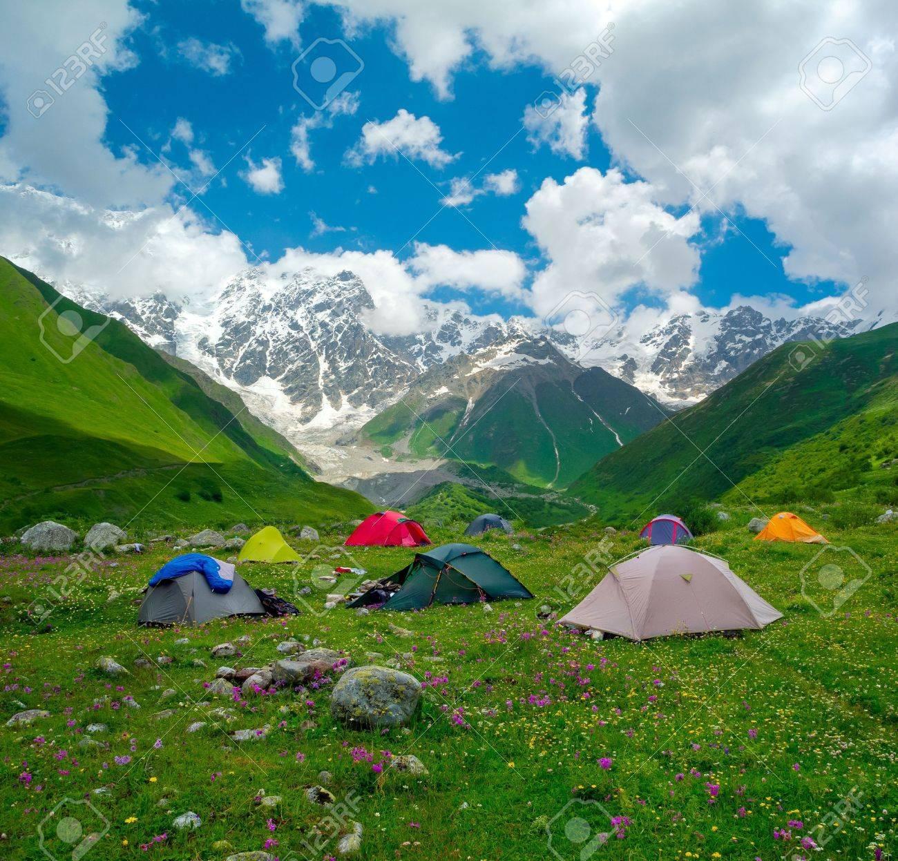 Hikers camp near Ushguli, Svaneti, Georgia. Shkhara mountain in the background - 21023319