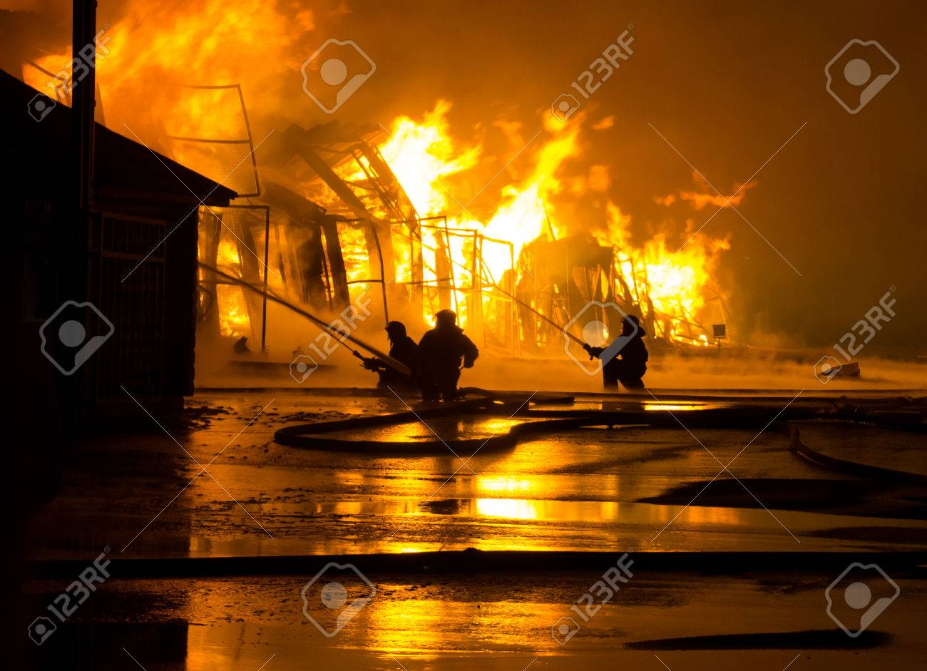 Firemen at work on fire - 28880297