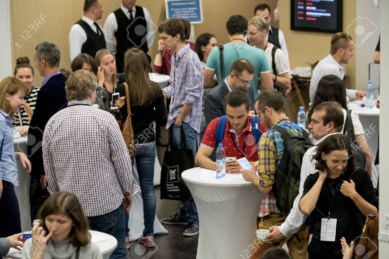 Moscow, Russia - September 2, 2016: People have coffee break during Digital Marketing Conference at Russia Today information agency hall - 63094164