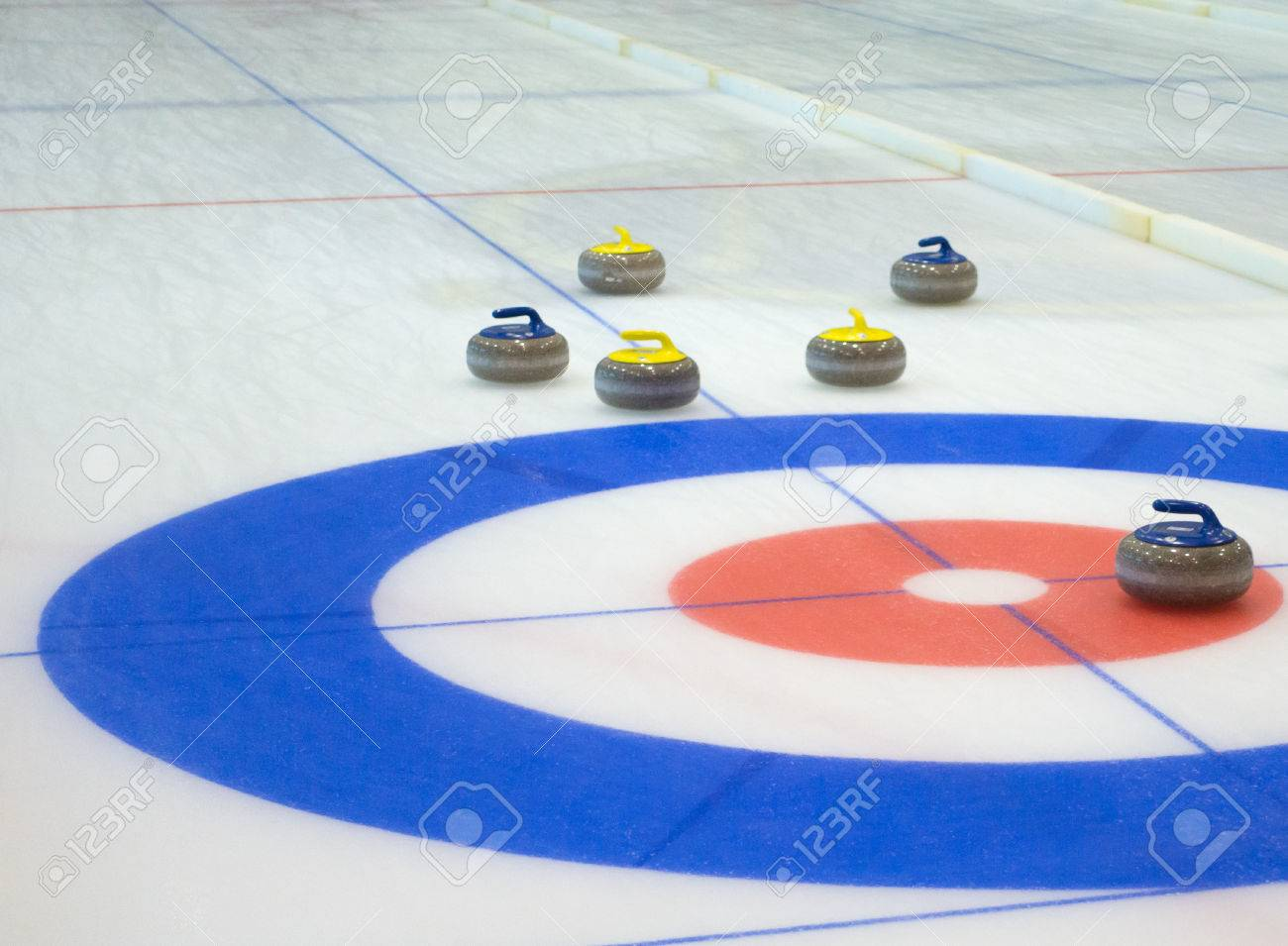 Curling stones equipment on the ice - 84425234