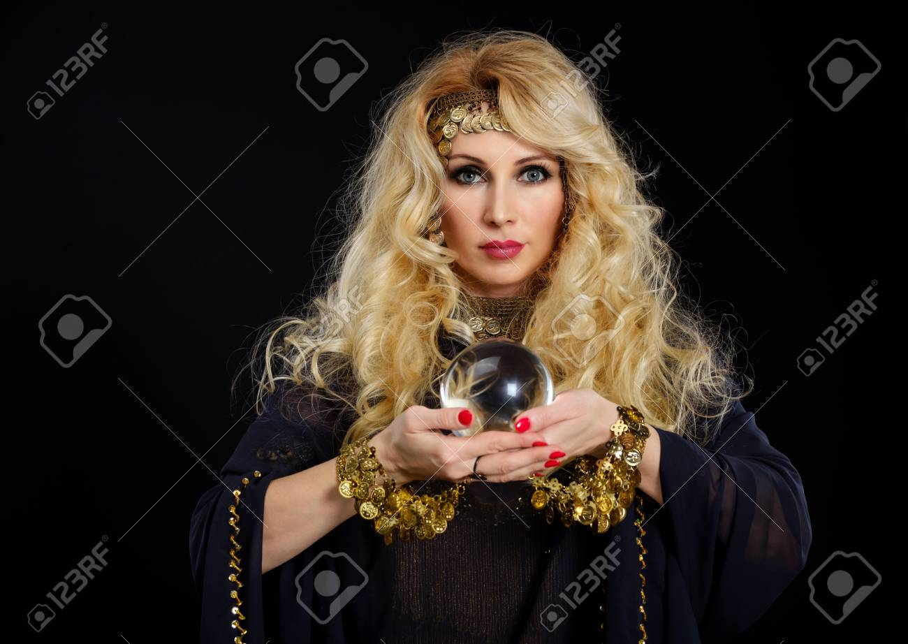 Woman fortune teller with crystal ball portrait on black - 89556751