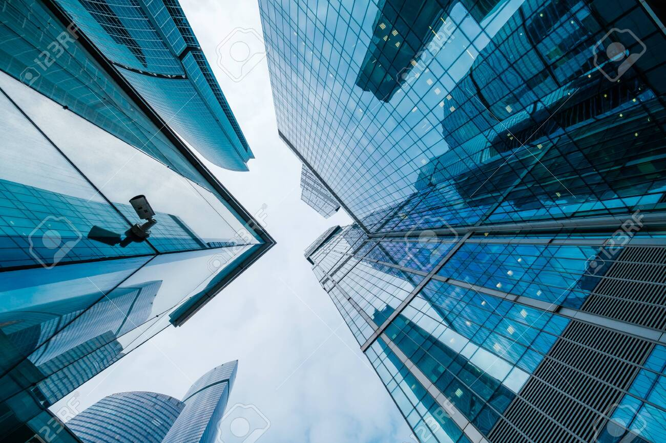 Skyscrapers in downtown area, bottom view, blue tones - 135582067