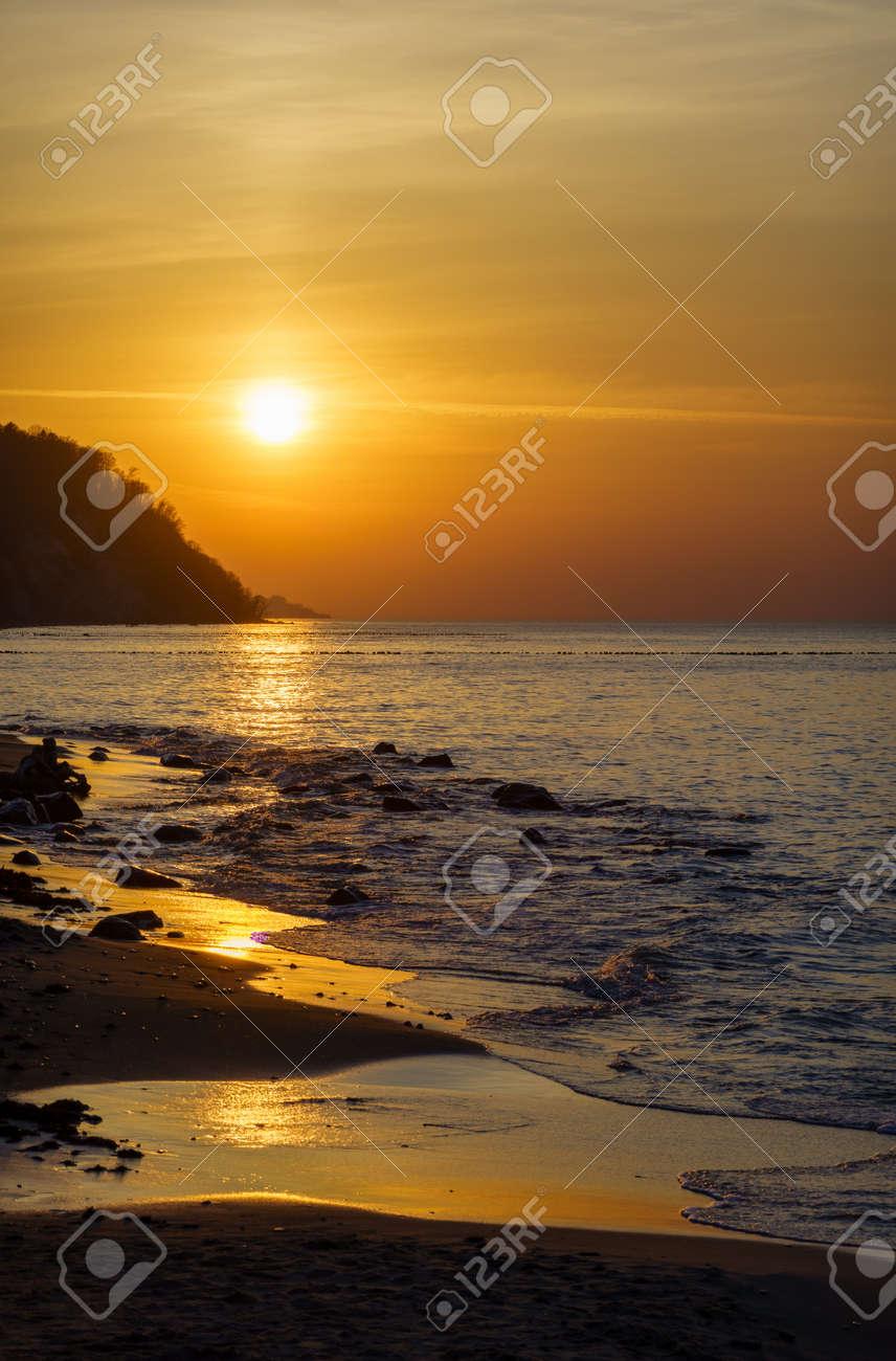 Beach and sea under sunset sky - 170229534