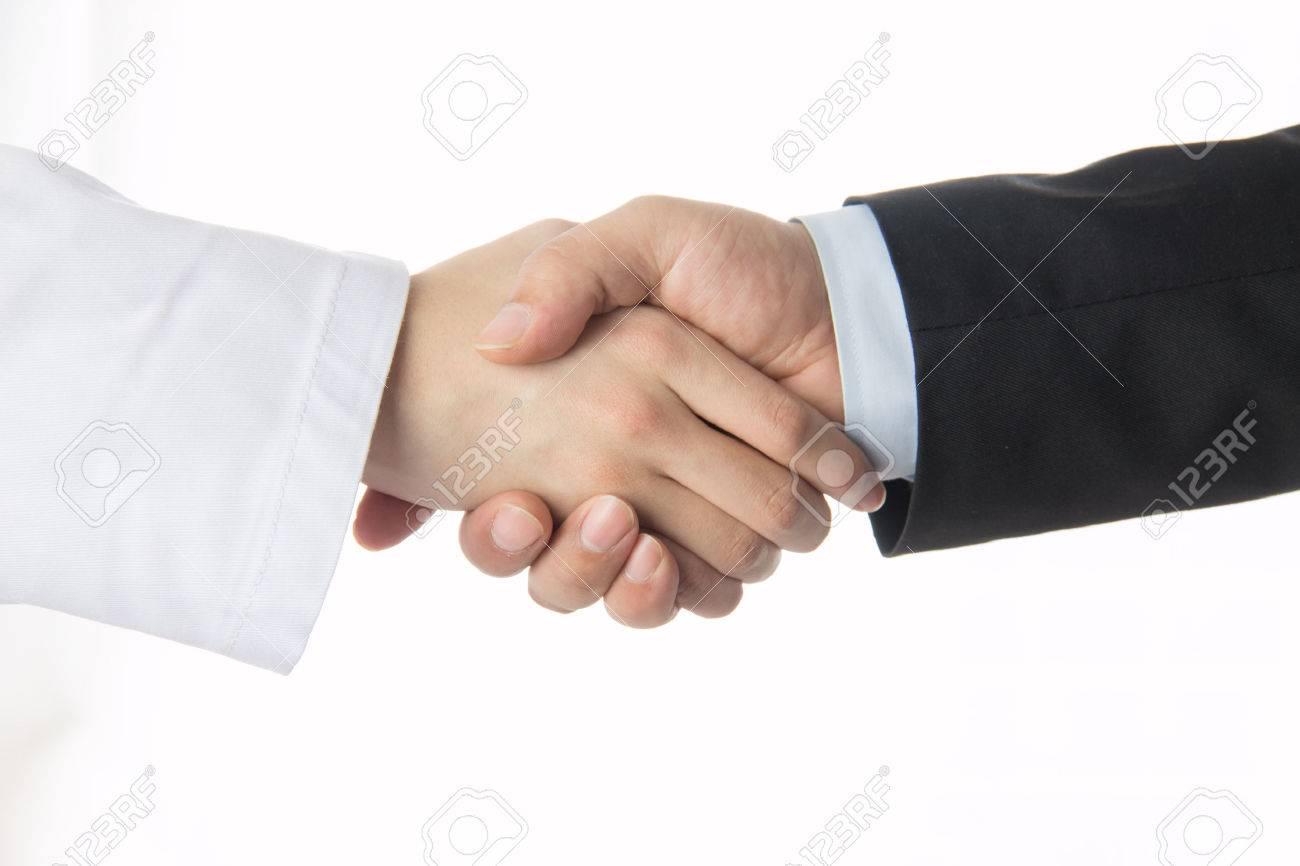 医師と握手するビジネスマン ロ...