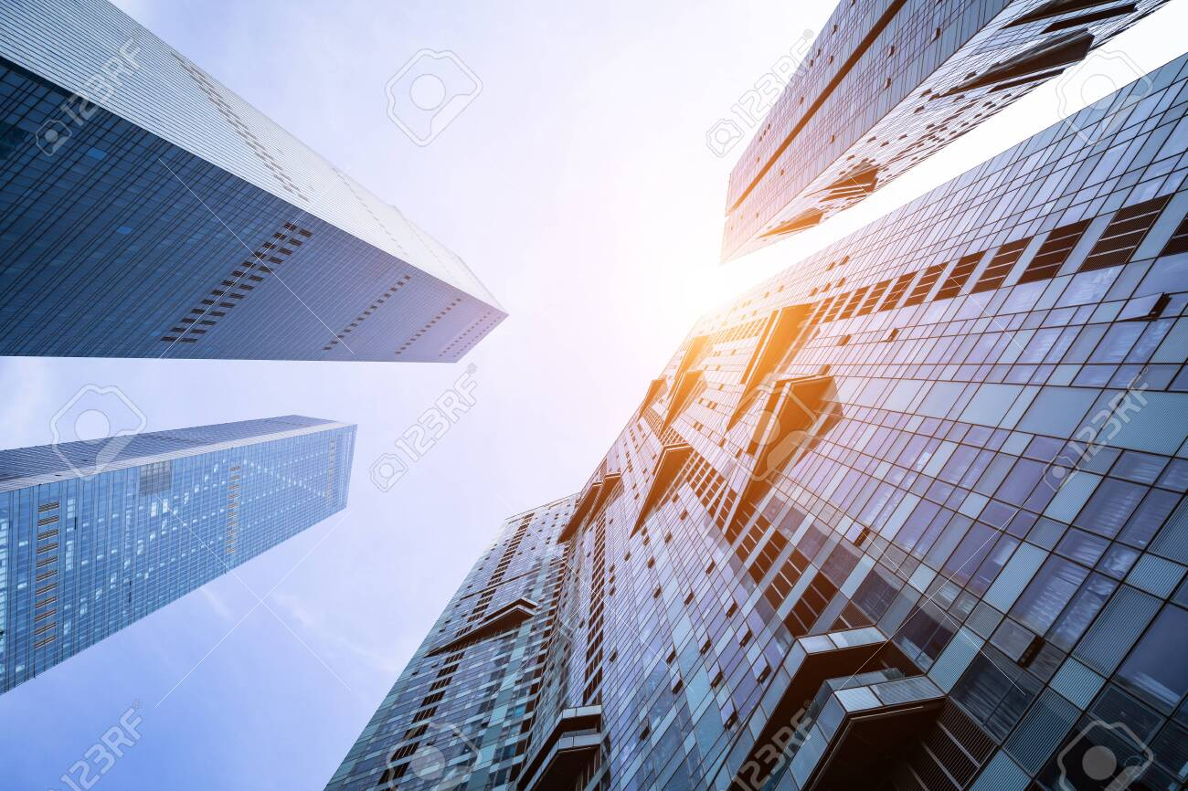 Low angle shot of modern glass buildings - 124531192