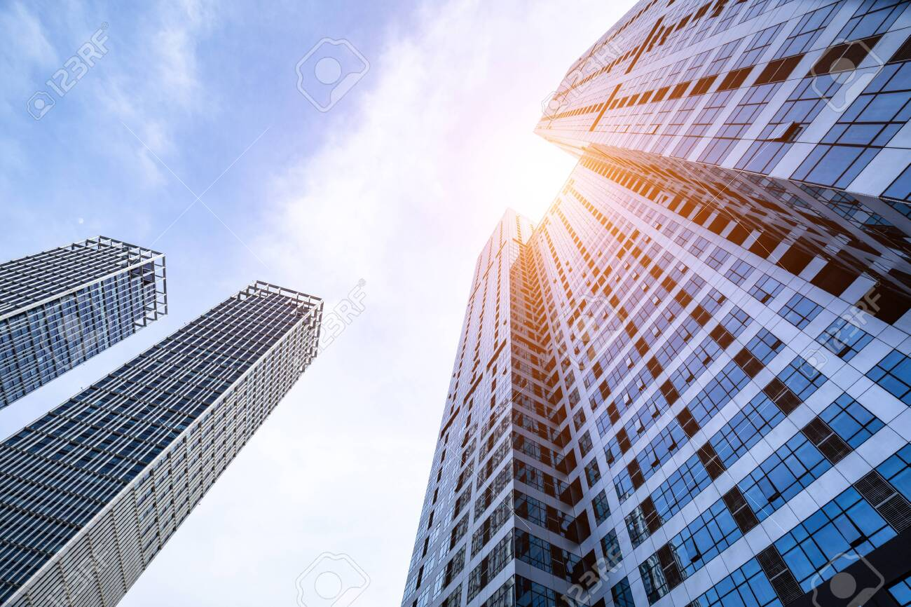Low angle shot of modern glass buildings - 124531266