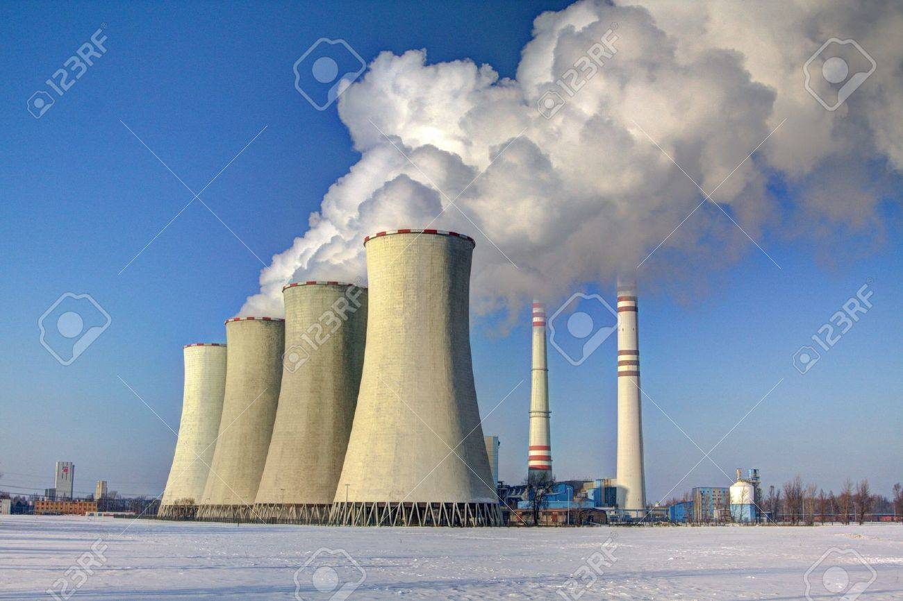 chimneys of coal-fired power plants in the winter snowy landscape Stock Photo - 13975046