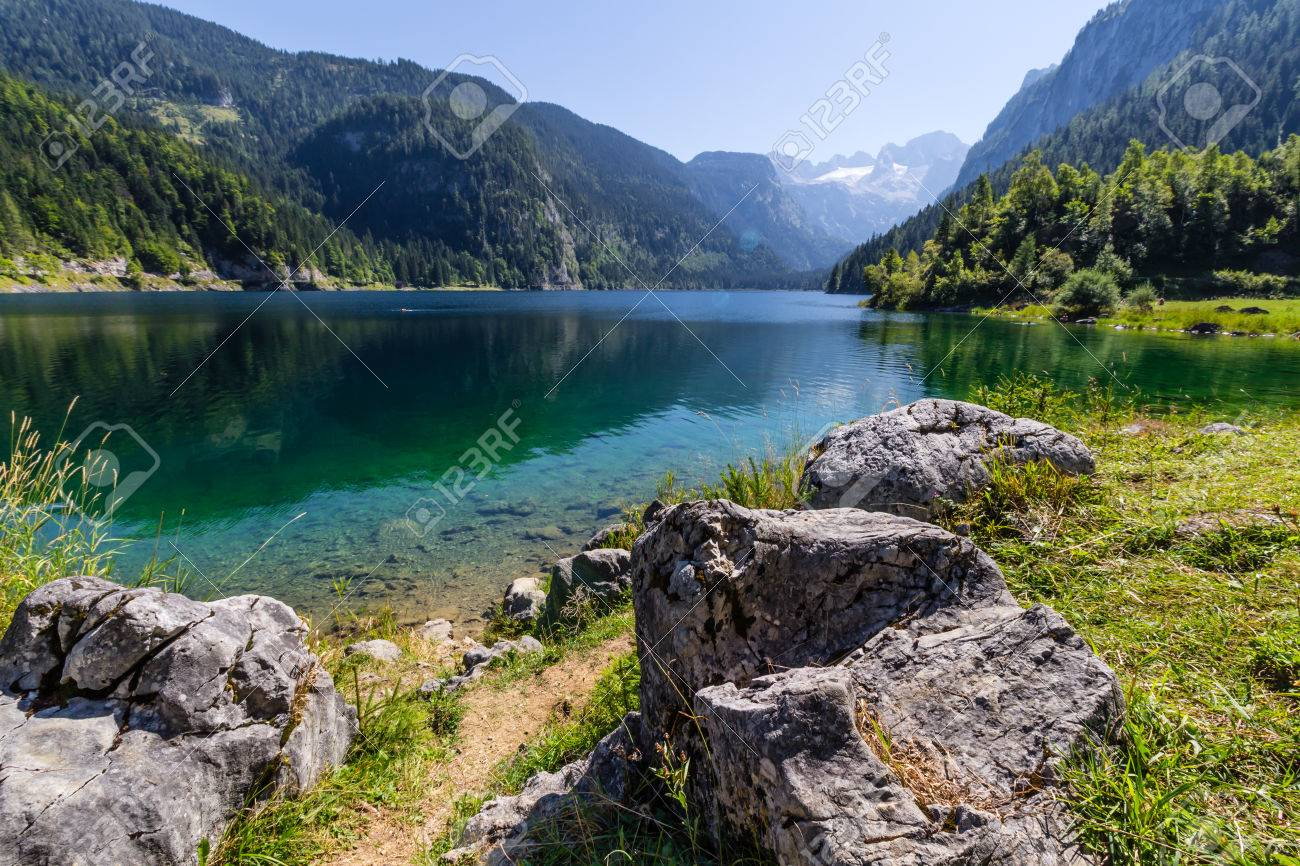 Beautiful landscape of alpine lake with crystal clear green water and mountains in background, Gosausee, Austria - 55923619