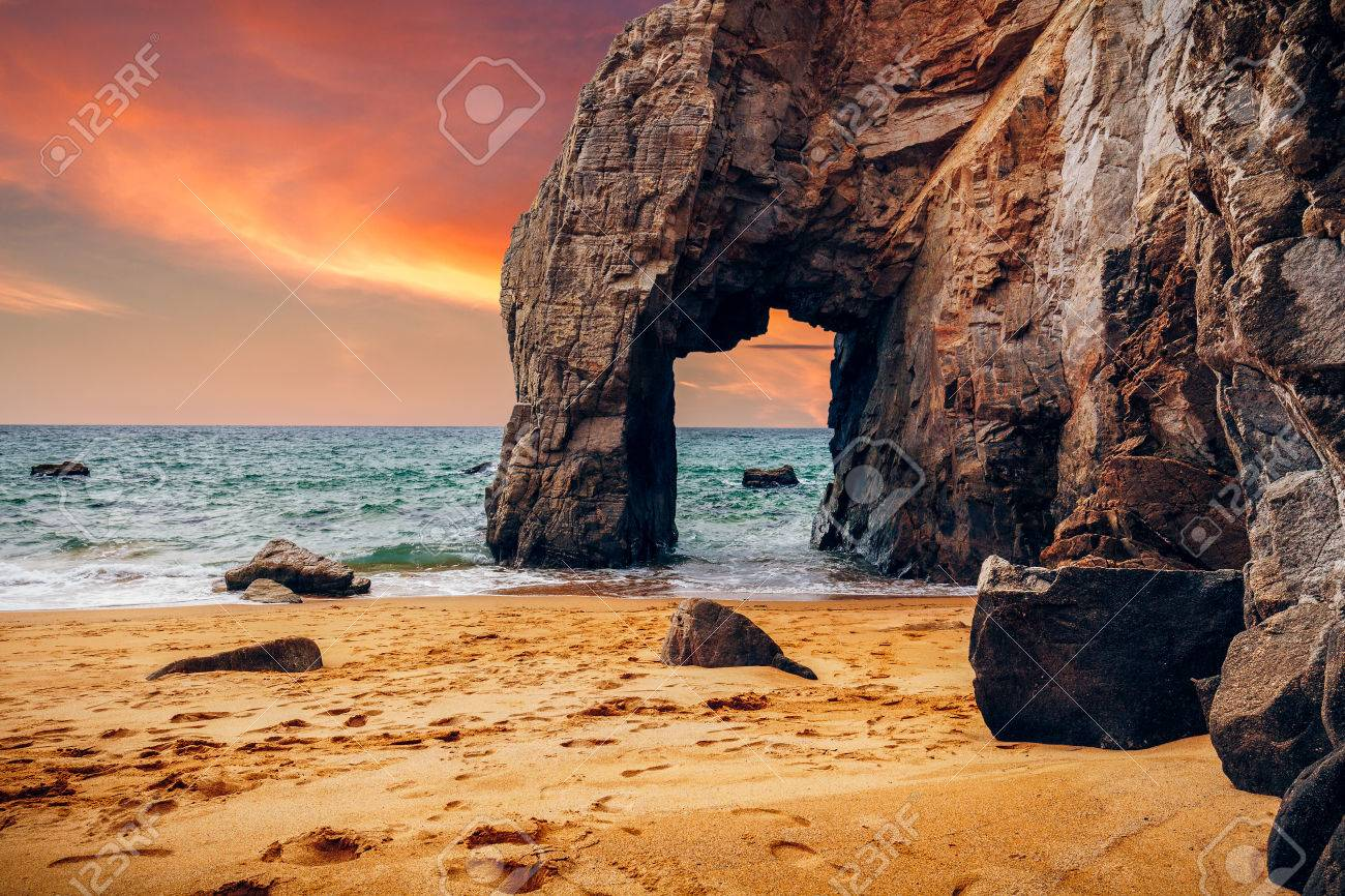 Spectacular natural cliffs and stone arch Arche de Port Blanc and beautiful famous coastline, Brittany (Bretagne), France, Europe - 82808786