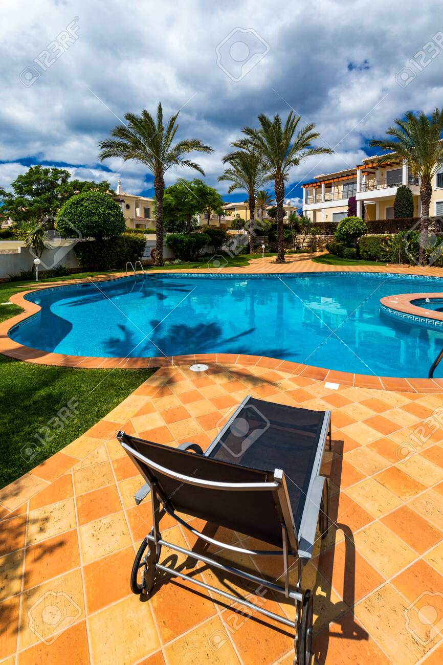 Great backyard with swimming pool, hot tub and lounge chairs...
