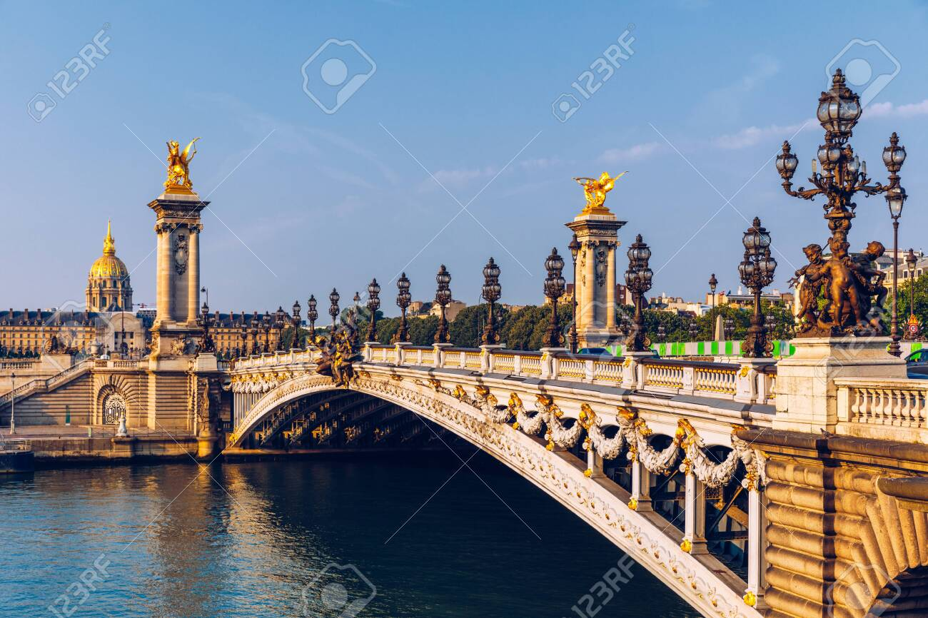 Pont Alexandre III bridge over river Seine in the sunny summer morning. Bridge decorated with ornate Art Nouveau lamps and sculptures. The Alexander III Bridge across Seine river in Paris, France. - 145419746