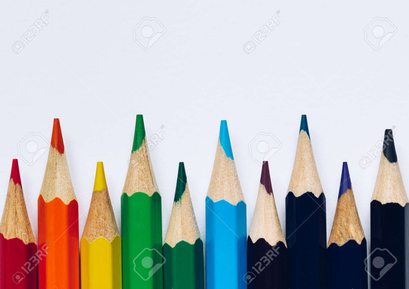 Color pencils isolated on white background. Close up of colored rainbow pencils for drawing, concept of preparing for school and discounts on stationery before the school year. - 168255345