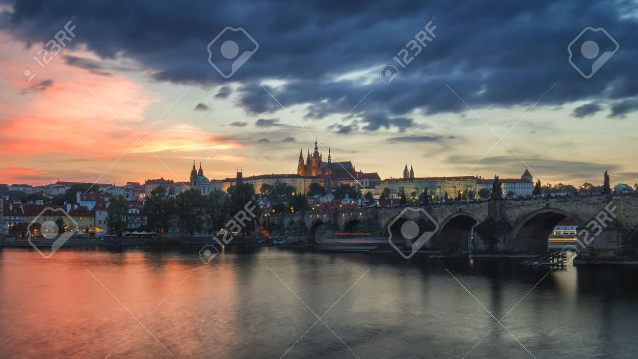 View of Prague Castle and Charles Bridge at sunset. Czechia - 168255348