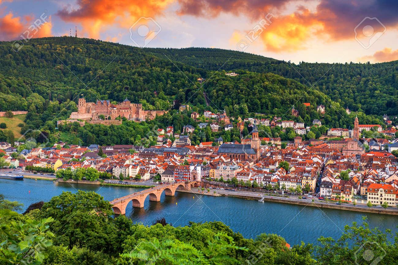 Landmark and beautiful Heidelberg town with Neckar river, Germany. Heidelberg town with the famous Karl Theodor old bridge and Heidelberg castle, Heidelberg, Germany. - 168255578