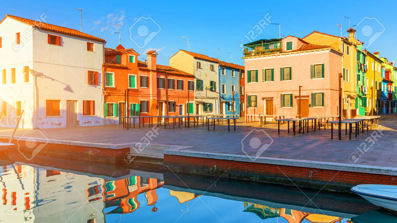 Street with colorful buildings in Burano island, Venice, Italy. Architecture and landmarks of Burano, Venice postcard. Scenic canal and colorful architecture in Burano island near Venice, Italy - 168255581