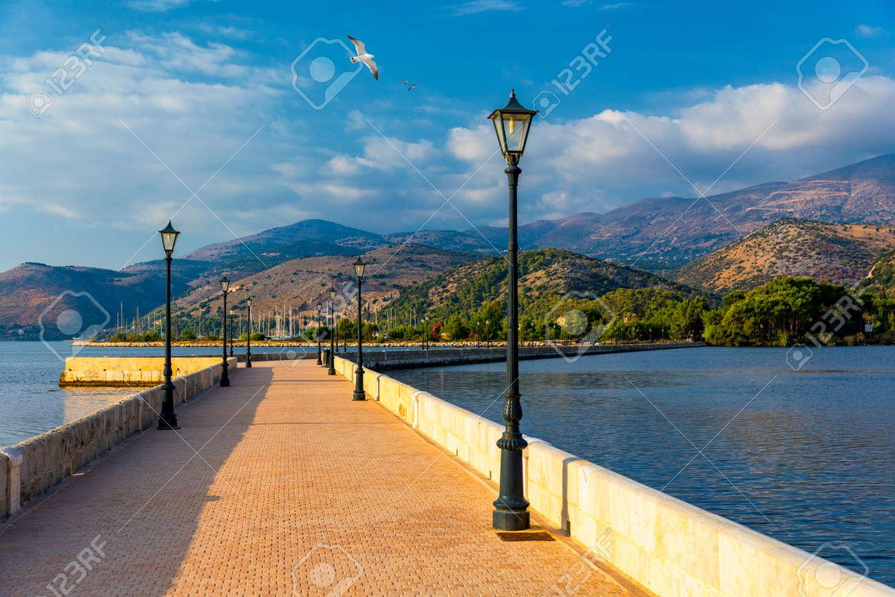 View of the De Bosset Bridge in Argostoli city on Kefalonia island. De Bosset Bridge on lakeside In Argostoli, Kefalonia. Obelisk and the de Bosset bridge in Argostoli, Kefalonia, Greece - 168255616