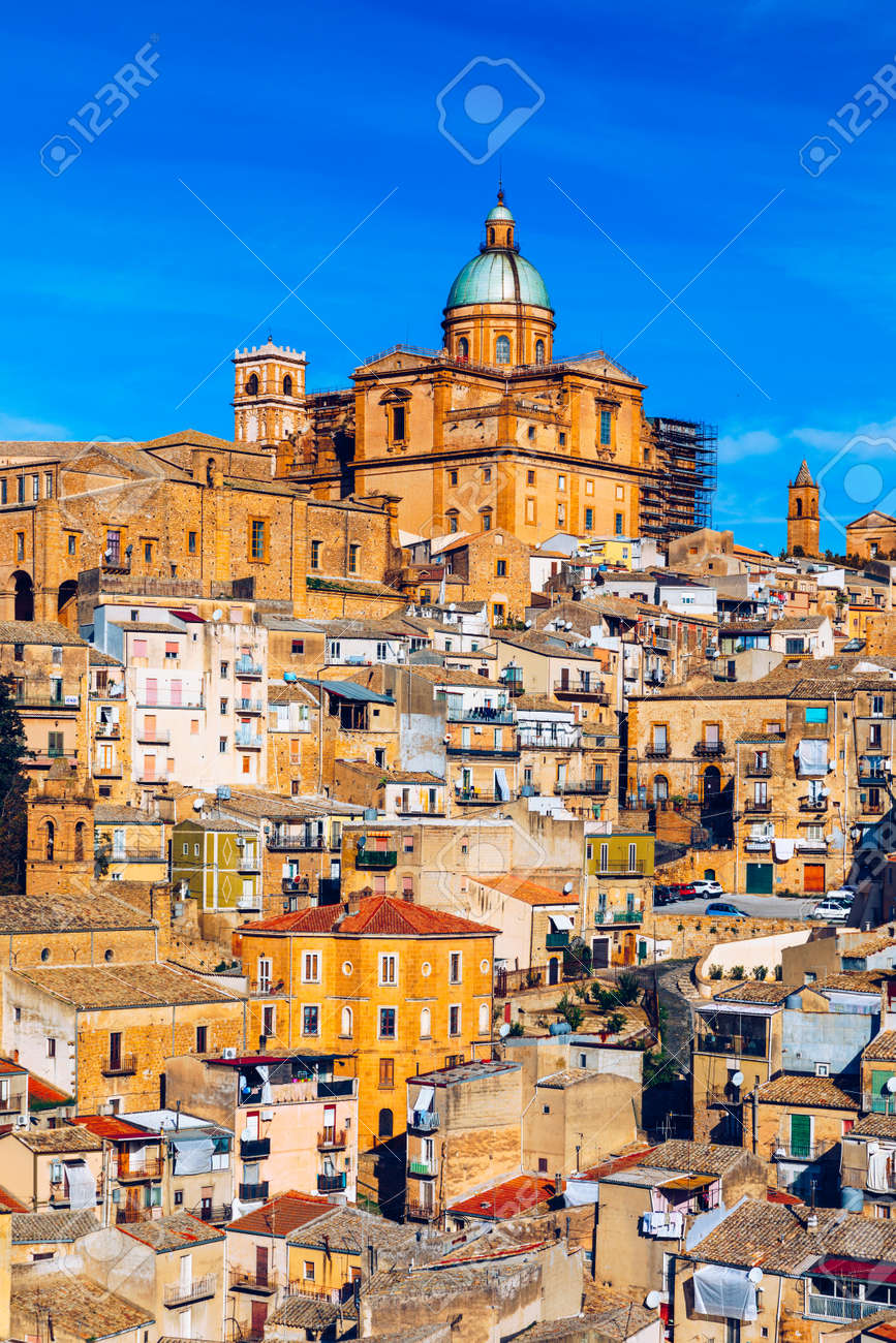 Piazza Armerina in the Enna province of Sicily in Italy. Piazza Armerina cityscape with the Cathedral SS. Assunta and old town, Sicily, Piazza Armerina, Province of Enna, Sicily, Italy, Europe. - 168255636