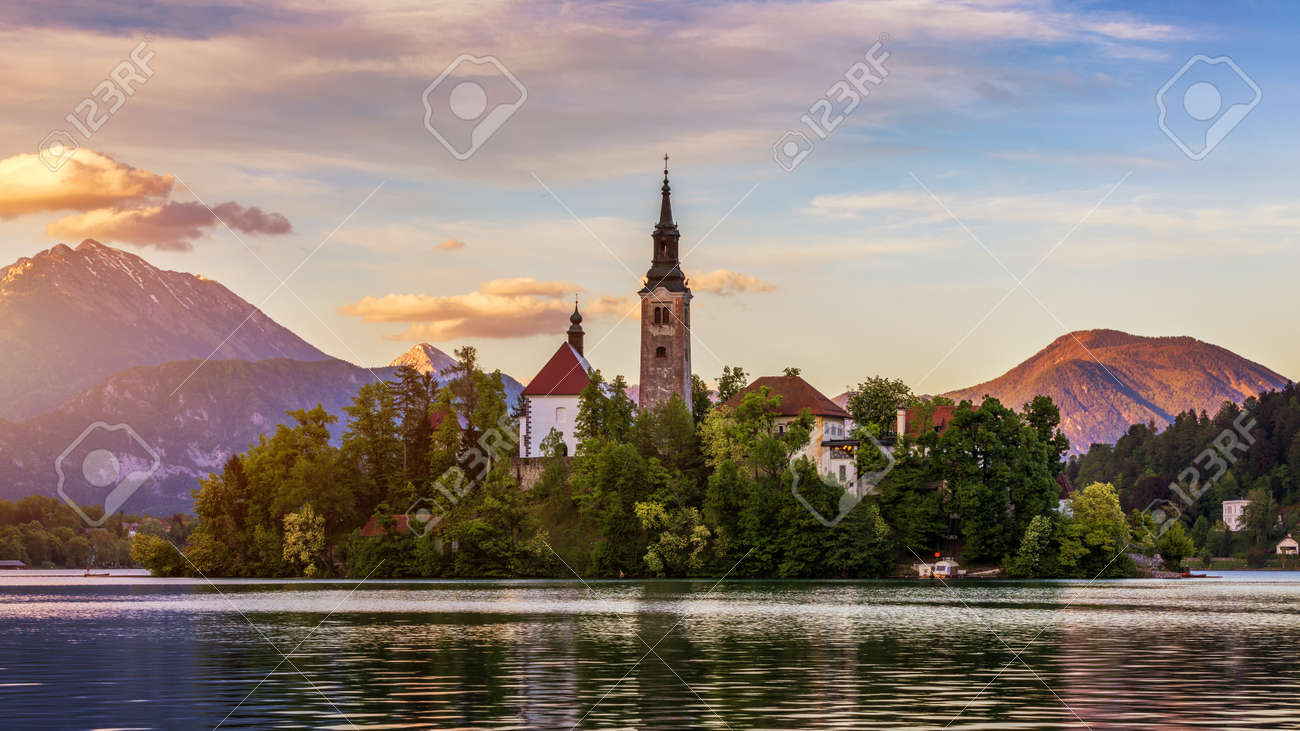Lake Bled Slovenia. Beautiful mountain lake with small Pilgrimage Church. Most famous Slovenian lake and island Bled with Pilgrimage Church of the Assumption of Maria. Bled, Slovenia, Europe. - 168255763