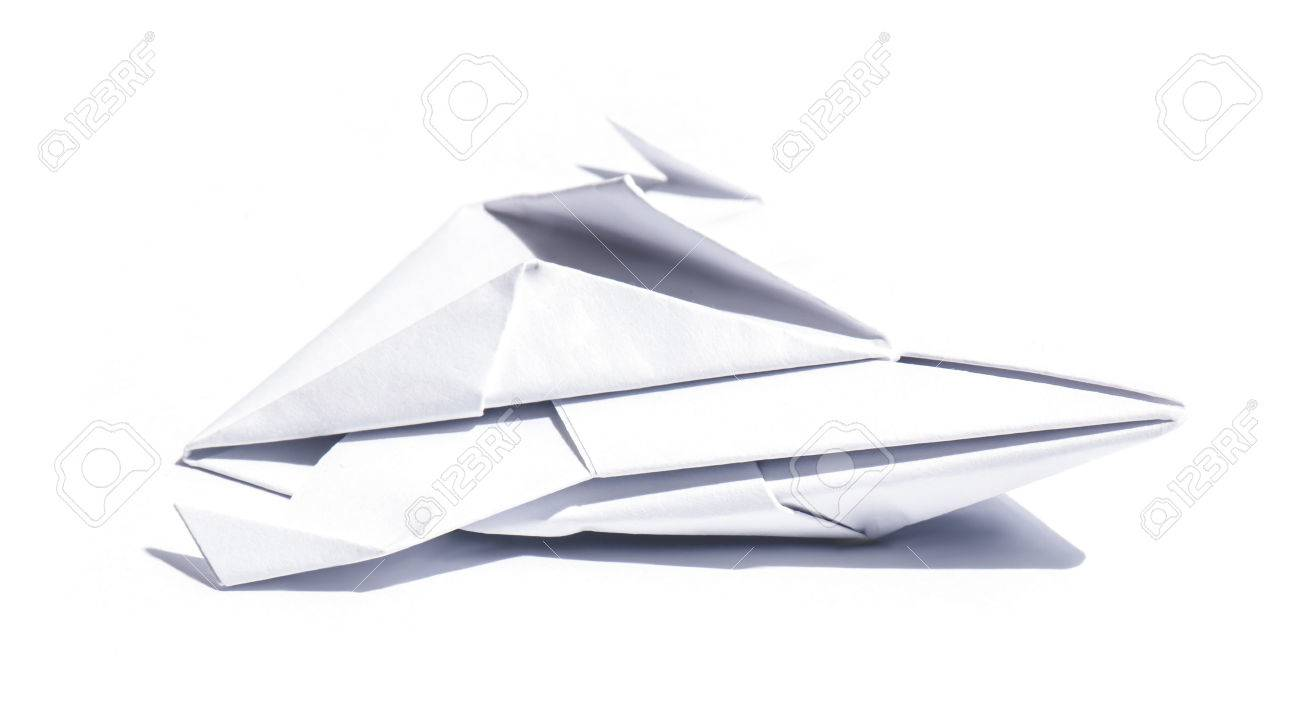 Side View Of A Nice Origami Spaceship Isolated Over Sheet Paper Stock Photo