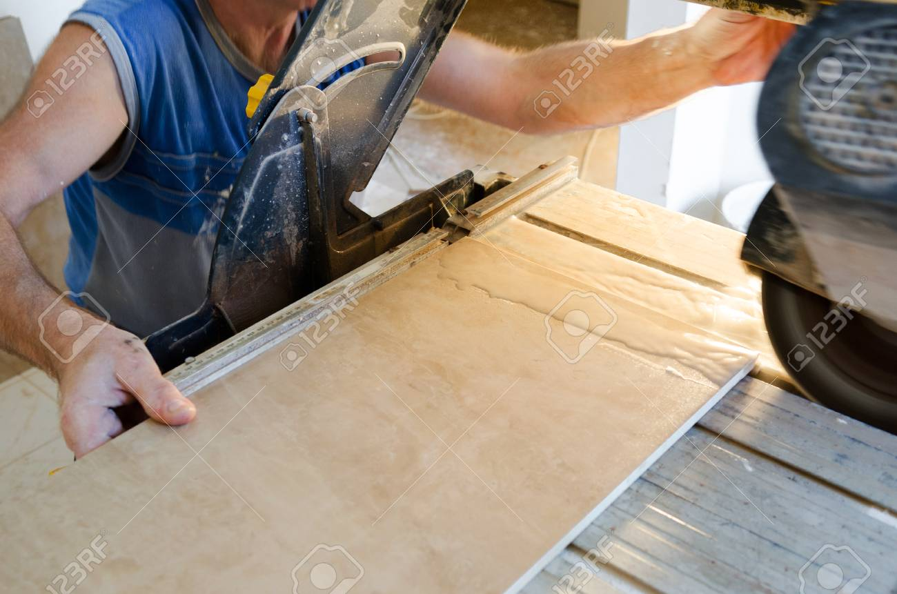 A wet saw cutter is being used to cut floor tile stock photo a wet saw cutter is being used to cut floor tile stock photo 25194331 dailygadgetfo Choice Image